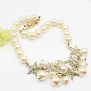 Pavé star & faux pearl statement necklace
